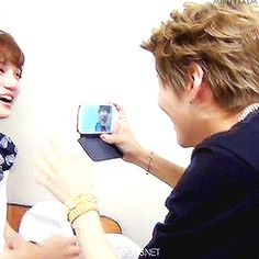 """and that's what friends are for ~ Taemin + Kai...Attack of the naughty maknae! Wae Tae? Wae?:) Actually, you know what Taemin could of been thinking, camera's are going to be all up in Kai's face for a very very loooooong time. All kinds of expressions will be captured then shared, gif'd, memed, macroed  made into other things. So whether it's a good or bad moment Taemin's like """"Get use to it man, if it's not me it'll be a fancam."""":)"""