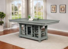 The Vintage Americana Dining Collection by Avalon Furniture combines superb visual appearance and fine quality that you need in your dining area. Constructed of rubberwood and pine solids in a brushed dove gray finish.