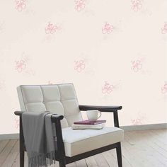 Harlequin Wallpaper Roll - Get Groovy with flowers in cream & pink. This floral design wallpaper has a creative pink flower design on a plain cream background. It's the perfect gentle addition to any room, giving a delicately elegant finish. Click to shop for yours now.