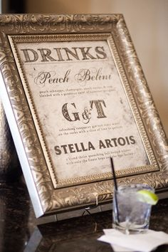 The Bride and Groom's drink ideas, maybe? In coordinating frames on the bar?