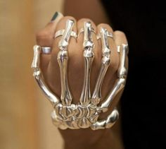 Skeleton Hand Bracelet - The skeleton ring and bracelet combo designed by Delfina Delettrez is available in silver or gold. Whatever the metal, it will make an impression on everyone who sees it (or leave one if you punch someone with it) Skeleton Hand Bracelet, Hand Bracelet With Ring, Skeleton Hands, Hand Ring, Ring Bracelet, Jewelry Bracelets, Jewlery, Slave Bracelet, Skull Bracelet