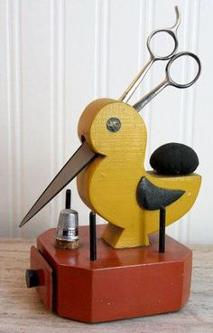 This antique folk art bird is from the 1920's. A rustic or primitive piece to organize your sewing scissors, thread, thimble and needles.