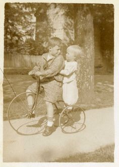 Siblings on a tricycle.  9015-003-001 #1127p.  Delaware Public Archives.  www.archives.delaware.gov