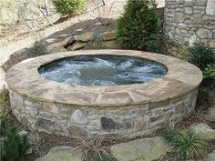 Our backyard would not be complete without a stone spa. I think I might forgo the new kitchen for awhile so I can have this right away!