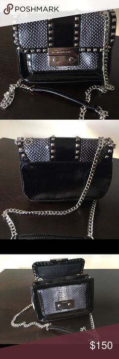 Michael Kors Small Sloan Studded Shoulder Flap Bag A trendy MICHAEL Michael Kors shoulder bag in black patent leather with snakeskin embossed details and silver tone hardware. Features include a push-lock closure, front pocket and fully lined interior with six credit card slots, a central compartment, one open pocket and one side zip pocket. Can be worn with the strap doubled over or extended. MICHAEL Michael Kors Bags Shoulder Bags