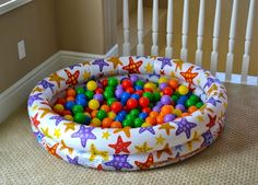 Use a blow-up pool to create an indoor large motor play space filled with balls.