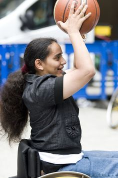 Action For Kids student Elif tries her hand at wheelchair basketball.