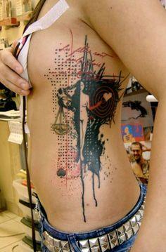 xoil - needles side tattoo.