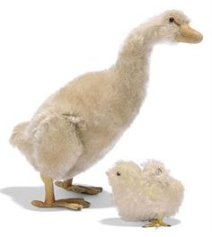 A STEIFF JOINTED GOOSE, (5322), white mohair, black boot button eyes, pink felt disc behind, felt beak and feet, jointed legs, squeaker and FF button with remains of white tag, circa 1913 --9in. (23cm.) high (some slight wear and thinning); and a small Chick, (6308), yellow mohair, black glass eyes, felt beak, wire feet wrapped in string and FF button with remains of white paper tag, circa 1924 --3¼in. (8.5cm.) long (some thinning and fading)