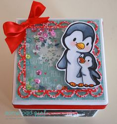 Melissa uses the Mommy and Baby Penguin digi stamp to make a festive shaker box. #christmascrafts #digitalstamps