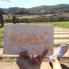 There's something real in sitting right on a ground in the middle of #antinori vineyard and sketching the hills of #tuscany around you. I was truly happy at that moment. #dailydoodle #ifdrawaweek