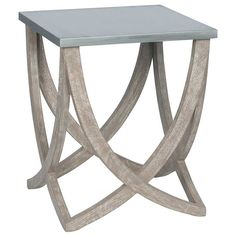 Sculptural and natural mango wood form the base of this statement side table. Topped with a distressed grey surface, it is neutral in colours but not in style!
