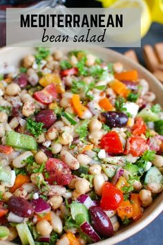 Mediterranean Bean Salad packs chickpeas, white beans, your favorite Mediterranean vegetables and feta cheese into one healthy salad and is topped with a light lemony dressing. This works perfectly as a side dish to a meal or even as lunch with pita bread and hummus. // acedarspoon.com #beans #salad #vegetarian #protein #lunch #mediterraneandiet Bean Recipes, Healthy Salad Recipes, Side Dish Recipes, Vegetarian Salad, Side Dishes, Vegetarian Recipes, Cooking Recipes, Vegetarian Protein, Healthy Lunches