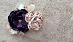 Eggplant and Champagne Corsage, fascinator, bridal sash. Eggplant and Champagne - Bridal Flowers, Wedding Accessories. $40.00, via Etsy.