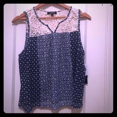 NWT Lace Accent Top A darling tank top with lace accent. New with tags, never worn. Is a size large. Will fit a medium. Ransom Tops Tank Tops