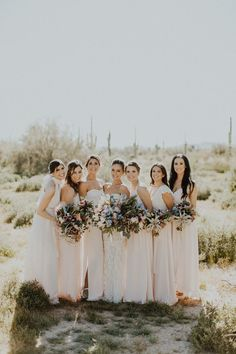 We love these mismatched bridal styles with white tops and pastel pink skirts | Image by Logan Cole