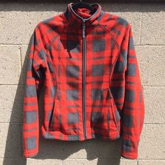 Rustic Plaid Fleece Turtleneck Zip Up Red, orange, and gray color. Great condition. Perfect for hiking, keeping warm indoors, or layering under coats. Zip up. Turtleneck that folds down. 2 front pockets. Fleece. Long sleeve. Tag says XS, but runs a little big, I'm a size S and this fit great, so may fit a size small comfortably. Merona Jackets & Coats