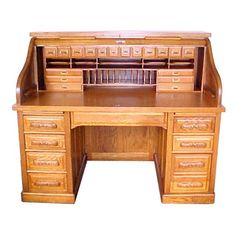 Fantastic antique American quartersawn oak rolltop desk with carved pulls raised panels and full interior circa 1890.