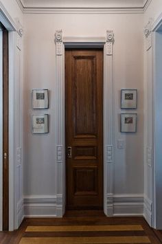 Super-slim walnut door leads to the powder room. & Reclaimed doors incorporated into a modern home.   For the Home ... pezcame.com