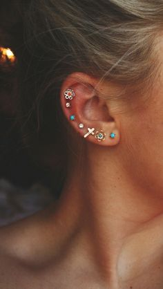 I love the all the earrings on her ear. It is just so chic.
