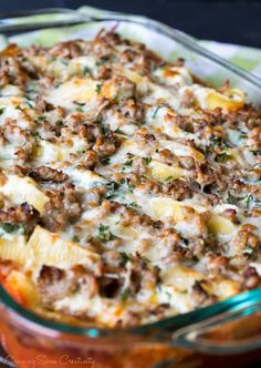 Easy Cheesy Stuffed Shells are a delicious main deal for the whole family. This recipe combines ricotta, mozzarella, and paresean cheeses, and spinach stuffed into the shells. A spicy layer of Hot or Mild Italian sausage completes the meal. A family favo Sausage Stuffed Shells, Easy Stuffed Shells, Spinach Stuffed Shells, Stuffed Shells Recipe, Sausage Recipes, Spinach Recipes, Pasta Recipes, Dinner Recipes, Cooking Recipes