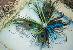 Peacock Feathers Batterfly Fascinator OR Brooch Pin. Custom colors for the accent feathers!    This piece, is made from vibrant peacock feathers for the wings, centered with a rhinestone cabochon and finsihed off with curled lime green and turquoise ostrich feathers. Bringing a delicate pop of color for any updo!