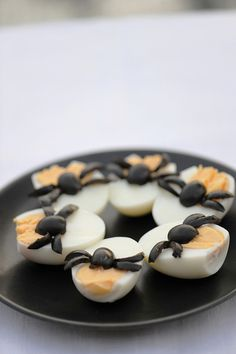 Delightfully fun black olive topped deviled eggs. #food #party #kids #appetizers #Halloween #fall #autumn #October #appetizers #eggs #cute