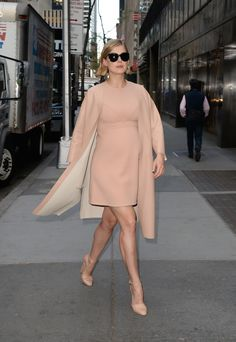 Headed to the Today show, Rosamund was a modern Audrey Hepburn in an all-nude look including a '60s-style Louis Vuitton dress and leather Marni coat. She completed the look with sky-high Marni heels and oversize sunglasses.