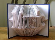 Folded book art, music, recycled book art book by Dancing Grey Studio