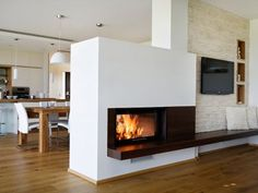 Modern fireplace as a room divider. The tunnel chimney forms the ideal center . Modern fireplace as a room divider. The tunnel chimney forms the ideal focal point in your living room and offers a view. Living Room Decor Fireplace, Bookshelves In Living Room, Fireplace Wall, Fireplace Design, Fireplace Ideas, Diy Outdoor Fireplace, Farmhouse Fireplace, Modern Fireplace, Farmhouse Interior