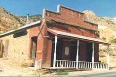 Gold Hill - Nevada Ghost Town. This is the Bank of California. Millions of dollars passed through here in the 1800s. I was able to go inside while a man was renovating the interior. The front overhanging cover and railing was not on the building in July 2014.