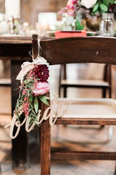 Bride chair sign rented from Petal Pushers | Floral by Petal Pushers | Photography by Mint Photography | #hillcountrywedding #texaswedding #bridesign #calligraphy #atxwedding #rusticwedding #bohemianwedding #weddingfloral #chairsign #bride #bridal