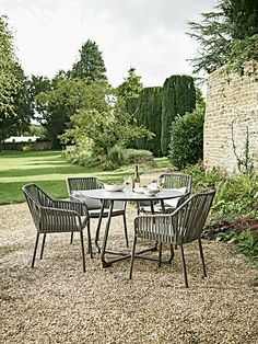 Crafted From Durable Material In A Unique And Stylish Design Our Outdoor Dining Set With Four Chairs And An Elegant Round Table Will Look Beautiful On Your