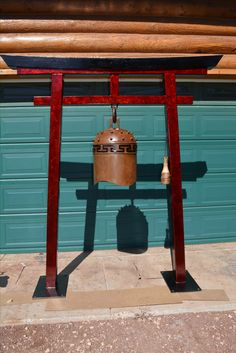 Bells made from tanks, Artist made temple bell, Bells made from recycled cylinders, Buddhist temple bells, Bells by Tom Williams, Bells by Twisted Horn Forge, Gongs, Garden bells, Torii gate, Torii gate bell, Bell sculpture, Artist, Steel bells, Bells made from steel. It's Elemental, Flagstaff Arts Council, Bells made from tanks, Bells made from recycled cylinders