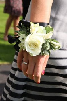 Wrist corsages for the bridesmaids and flower girls. I like this idea because after the ceremony, the bridesmaids don't really carry the bouquets..
