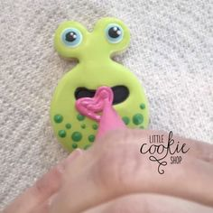 Mister green monster! He likes hearts. #nomnom    #littlecookieshop #monster #sugarcookies #cookiedecorating #cookievideo
