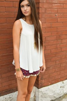 Fun tassel shorts and long necklace with white tank.