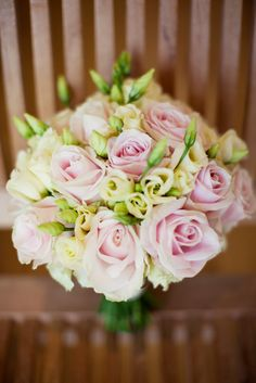 Hand tied Brides bouquet using a pastel mix of sweet avalanche roses and yellow lisianthus