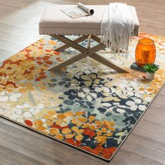 Add excitement to your space with the brightly colored abstract floral design. This rug is extremely durable and vibrant.