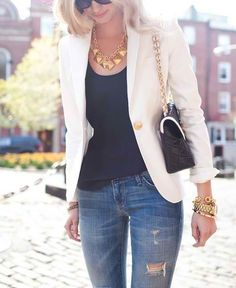 White blazer over jeans and gold acessories