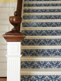 Looks like Mexican tile on the stair risers but I used wallpaper! Fun project I did for DIY NETWORK :)  http://www.diynetwork.com/decorating/how-to-makeover-a-staircase-using-paint-and-wallpaper/page-2.html  Joanne Palmisano, www.salvagesecretsblog.com