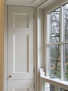 BUILT IN CABINETS IN WINDOW SURROUND