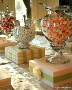 """Wrap a simple box with fabric and ribbon for a """"custom"""" look on your candy station."""