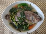 Filipino Recipe Sinigang na Tilapia (Tilapia in Sour Soup)  2 medium tilapia, cleaned  1 root ginger, sliced  1 tomato, quartered  bunch kamote leaves  1 1/2 tbsp sinigang mix  1 tsp salt  2 jalapeno pepper