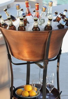 Hand-hammered Copper Beverage Tub holds enough drinks and ice to keep a crowd refreshed for hours and is sure to be an eye-catching focal point at your next party.