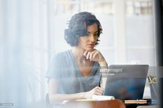 Stock Photo : Businesswoman using laptop in office