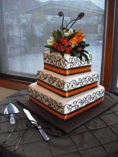 Bold orange and black wedding cake.. compromise.  Orange and Black for Matt but still classy enough for me