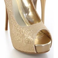 ✨Flashy sparkle heels ✨ These glittery golden peep toe pumps are the perfect height and never hurt my feet. Gold is the new black and these hot heels go with any outfit. Dress up some black jeans for girls night or rock 'em with that LBD for date night. Only worn once! Make me an offer :) Shoes Heels