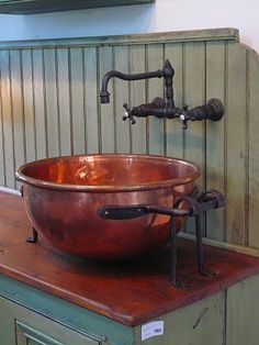 Love this cooper bowl sink! Maybe not as the main sink, but a fun & unusual auxiliary sink...