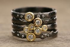 Black rhodium-plated sterling silver rings with 18k yellow gold bezels with diamonds; $290–$450; Yasuko Azuma Jewelry